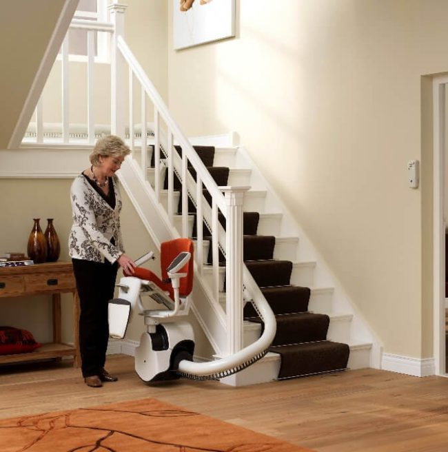 Elder Women Operating Flow2 Indoor Stairlift