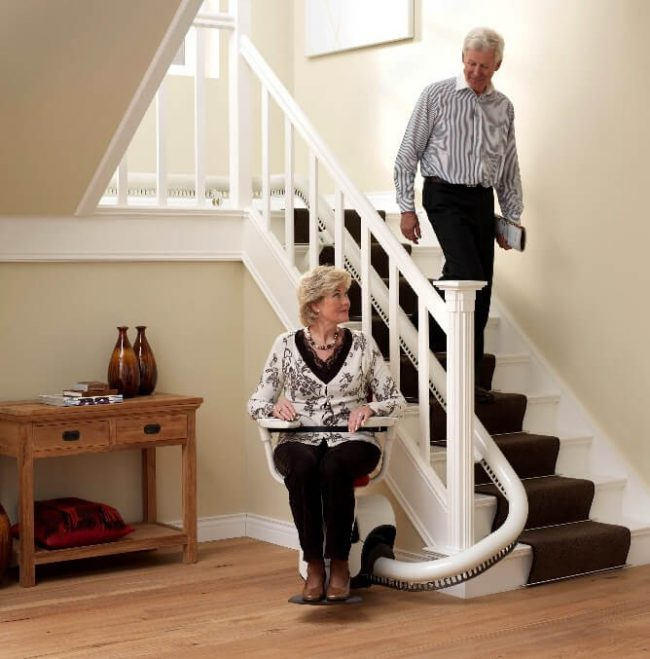 Elder Women Seating on Flow2 Indoor Stairlift