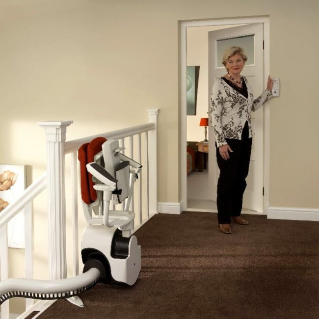 Women near Control of Flow2 Indoor Curved Rail Stairlift