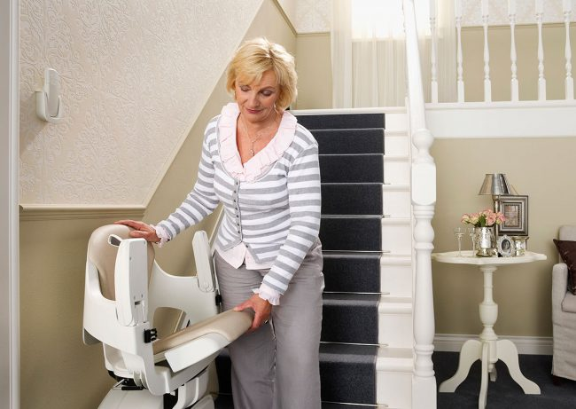 women with indoor straight rail stairlifts